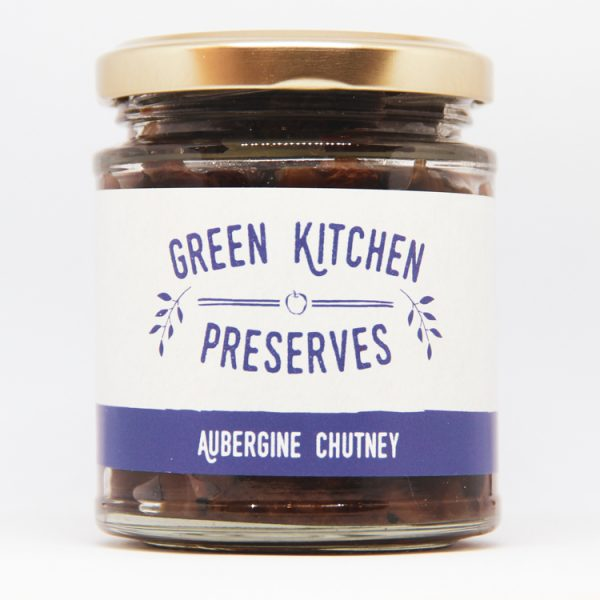 a jar of aubergine chutney on a white background