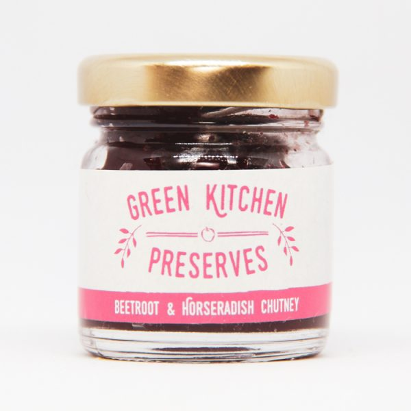 a small jar of beetroot & horseradish chutney on a white background