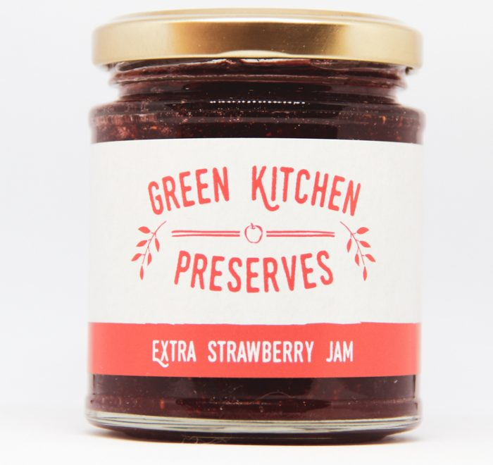 a jar of strawberry jam on a white background