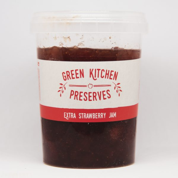 a large wholesale tub of strawberry jam for catering businesses on a white background