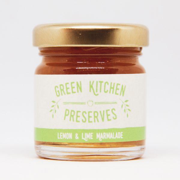 a small jar of lemon & lime marmalade on a white background