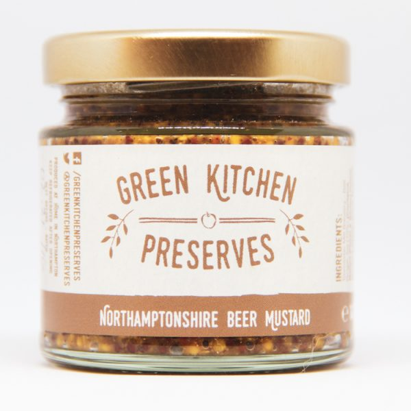 a jar of whole grain northamptonshire beer mustard on a white background