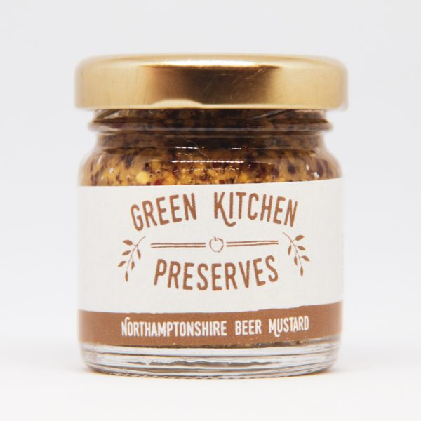 a small jar of whole grain northamptonshire beer mustard on a white background
