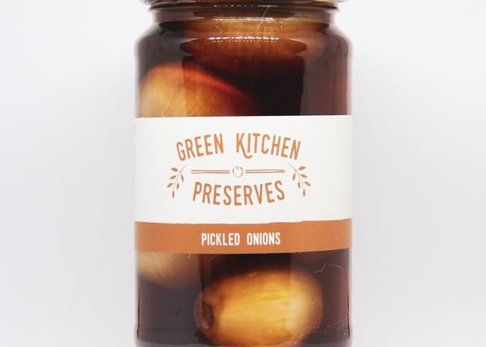 a large jar of pickled onions on a white background