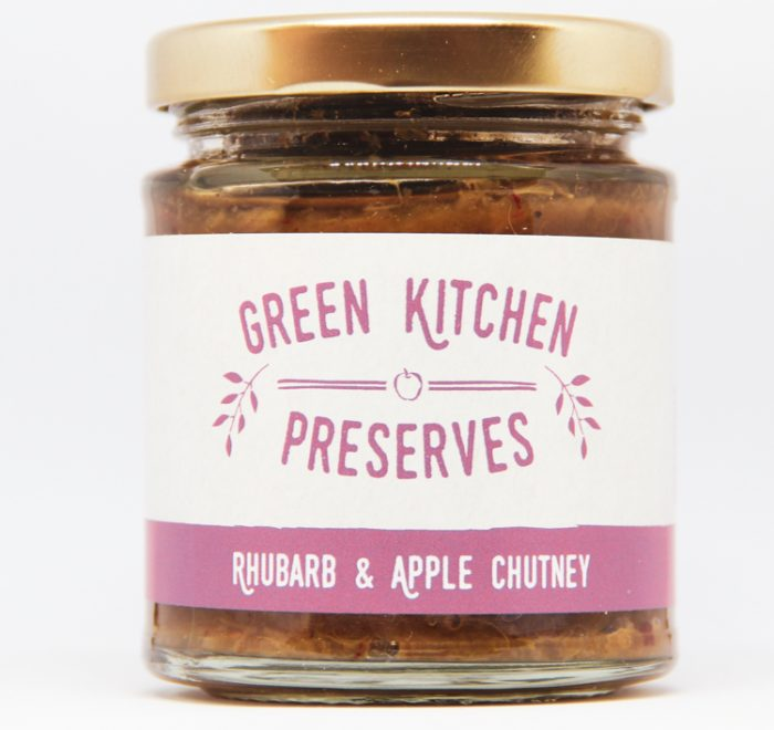 a jar of rhubarb & apple chutney on a white background