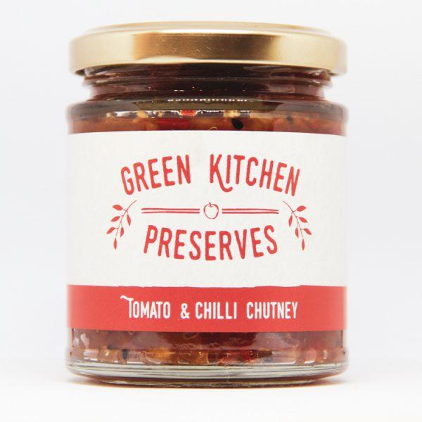 a jar of tomato & chilli chutney on a white background